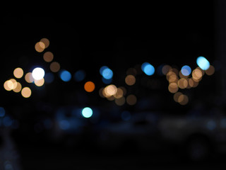Colorful bokeh street lights defocused background