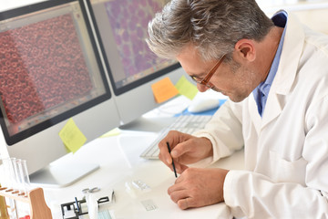 Microbiologist in office working on sample