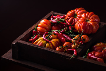 red tomatoes and peppers in a box