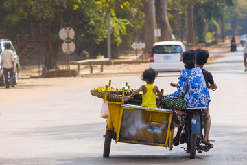Cambodian family on motorbike travel to sell food