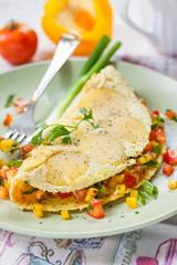 Mediterranean omelet with potatoes, full of fresh vegetables