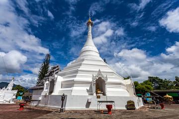 Beautiful of Lanna temple Wat Phra That Doi Kong Mu with blue sky