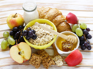 set of products for a healthy breakfast, oatmeal, fruit, honey