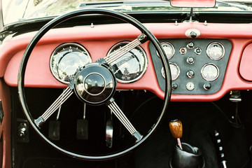 Steering wheel and dashboard in historic vintage car, photo