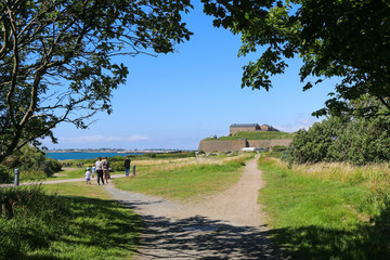 Varberg, Sweden. Castle of Varbergn and sea. Photo taken through the trees.