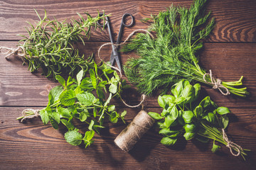 Fresh herbs on an old wooden table