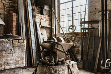 Old Workshop of blacksmith with anvil and horse harness