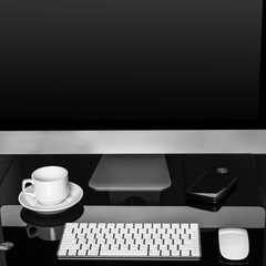 computer on a table in an office