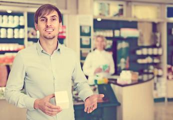 Handsome man   in pharmacy drugstore