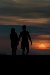 Sunset Scene of Couple Silhouette Holding Hands