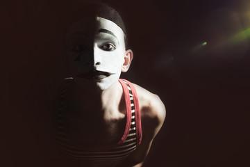 Sad mime on black