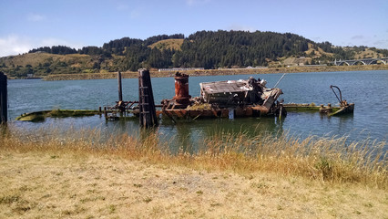 Crashed Old Tugboat/Old broken down tugboat sitting in the shallows.