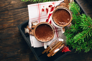 Christmas mugs of hot chocolate and homemade gingerbread cookies, top view. Christmas Holiday background, vintage style.
