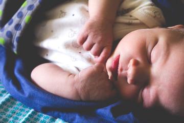 Sweet one month old newborn baby boy is sleeping