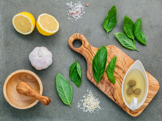 The ingredients for homemade pesto sauce : basil, parmesan chees