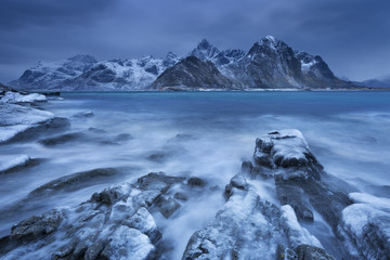 Wall Mural - Dark clouds over a fjord in Norway in winter