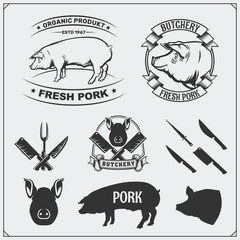 Vector pork meat labels and design elements. Butcher's business logos. Silhouettes of pig and cutlery.