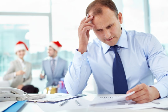 Manager working in office on holiday