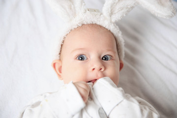 portrait of adorable baby in Bunny suit..