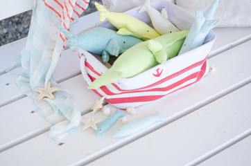 handmade toy whale on the wooden floor in the basket