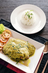 thai cambodian fish fillet with asian green curry sauce meal