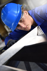 Girl attending metalworks training course