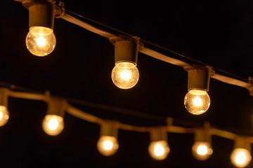 Isolated black pendant lamp or light, warm