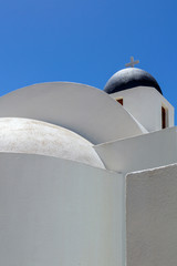 Minimalist view of white chapel with blue dome