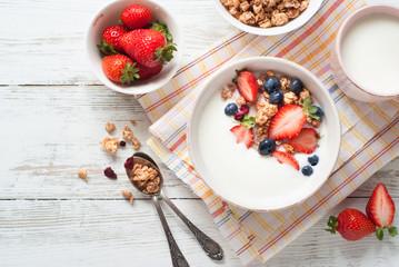 Yogurt with granola and berries.