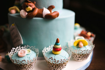 nice teddy bear lying on the cake