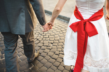 bride and groom hold each other's hand