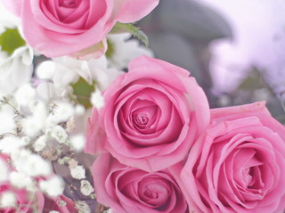 Bouquet of beautiful flowers as a background. Selective focus on pink roses.