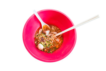 Asian noodle soup in a red bowl  Isolated on white background,Spicy noodle,tom-yum-noodles, Top view