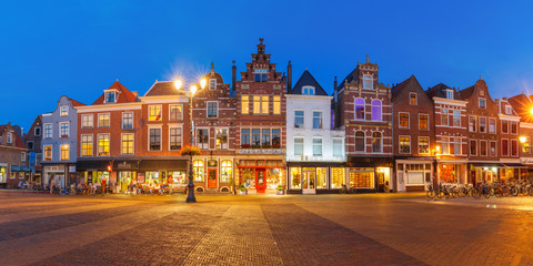 Panorama of typical Dutch houses on the Markt square in the center of the old city at night, Delft, Holland, Netherlands