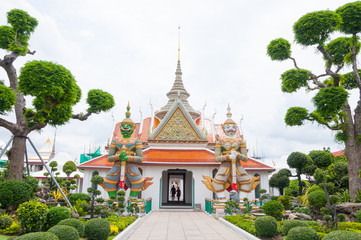 Entrance to Wat Arun buddhist temple,Wat Arun Ratchawararam or the Temple of Dawn. Thailand iconic decorated by ceramics ,Giant statue in wat arun bangkok thailand ,Amazing Thailand
