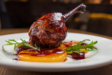 Duck confit on white plate, restsurant