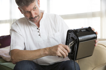 middle aged man fixing a toaster