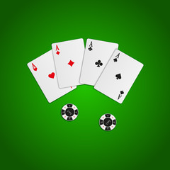 Four aces and casino chips. Playing cards isolated on green background.