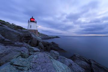 Lighthouse on a rocky shore.