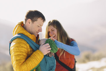 Young couple with baby hiking in mountains