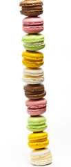 colourful Macroons stacked on top of each other on white background