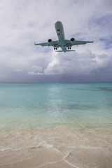 Airplane Landing near Beach