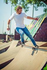 Skateboarder riding in skate park