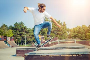 Skater jumping in skateboard park