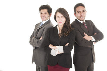 two latin businessmen and a businesswoman in suits posing