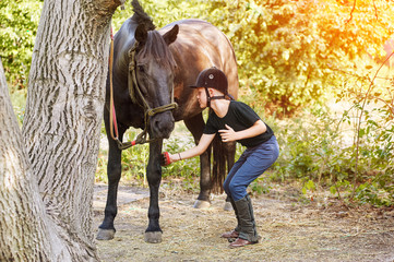 Boy jockey , cleans your horse after a workout