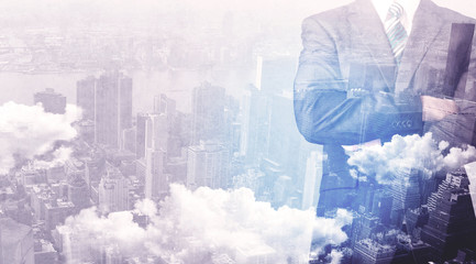 Business man standing at city view background