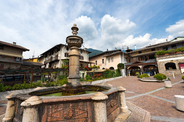 Ancient octagonal fountain (1553) in Levico Terme, Trentino Alto Adige, Italy, Europe
