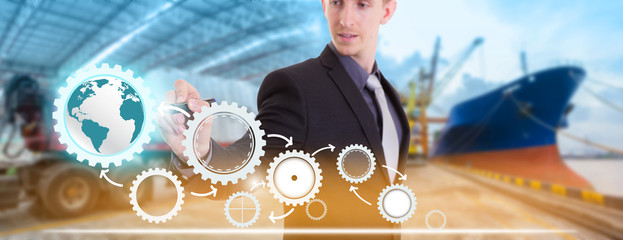 Businessman writing supply chain management logistics with import export background