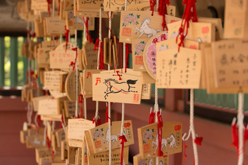 Small wooden plaques at japanese shrine